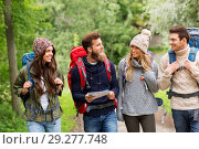 Купить «friends or travelers hiking with backpacks and map», фото № 29277748, снято 31 августа 2014 г. (c) Syda Productions / Фотобанк Лори