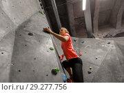 Купить «young woman exercising at indoor climbing gym», фото № 29277756, снято 2 марта 2017 г. (c) Syda Productions / Фотобанк Лори