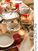 Купить «table served and decorated for christmas dinner», фото № 29277768, снято 14 декабря 2017 г. (c) Syda Productions / Фотобанк Лори