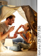 Купить «family playing tea party in kids tent at home», фото № 29277836, снято 27 января 2018 г. (c) Syda Productions / Фотобанк Лори