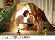 Купить «family with tablet pc in kids tent at home», фото № 29277840, снято 27 января 2018 г. (c) Syda Productions / Фотобанк Лори