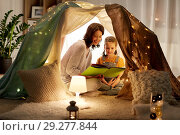 Купить «happy family reading book in kids tent at home», фото № 29277844, снято 27 января 2018 г. (c) Syda Productions / Фотобанк Лори