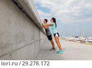 Купить «couple with fitness trackers exercising outdoors», фото № 29278172, снято 1 августа 2018 г. (c) Syda Productions / Фотобанк Лори