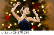 Купить «smiling woman dancing with raised hands», фото № 29278296, снято 1 июня 2014 г. (c) Syda Productions / Фотобанк Лори