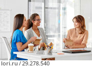 Купить «happy businesswomen eating take out food at office», фото № 29278540, снято 17 марта 2018 г. (c) Syda Productions / Фотобанк Лори
