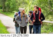 Купить «happy friends or travelers hiking with backpacks», фото № 29278580, снято 31 августа 2014 г. (c) Syda Productions / Фотобанк Лори