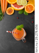 Купить «mason jar glass of fruit juice on slate table top», фото № 29278656, снято 4 апреля 2018 г. (c) Syda Productions / Фотобанк Лори