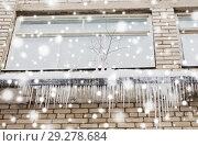 Купить «icicles on building or living house facade», фото № 29278684, снято 11 ноября 2016 г. (c) Syda Productions / Фотобанк Лори