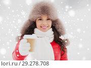 Купить «happy woman in winter fur hat with coffee outdoors», фото № 29278708, снято 7 января 2017 г. (c) Syda Productions / Фотобанк Лори