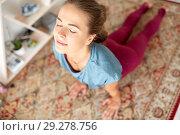 Купить «woman doing upward-facing dog pose at yoga studio», фото № 29278756, снято 21 июня 2018 г. (c) Syda Productions / Фотобанк Лори