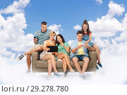 Купить «friends with tablet pc and smartphones over sky», фото № 29278780, снято 30 июня 2018 г. (c) Syda Productions / Фотобанк Лори