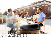 Купить «happy friends at barbecue party on rooftop», фото № 29278816, снято 2 сентября 2018 г. (c) Syda Productions / Фотобанк Лори