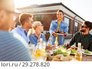 Купить «friends at barbecue party on rooftop in summer», фото № 29278820, снято 2 сентября 2018 г. (c) Syda Productions / Фотобанк Лори