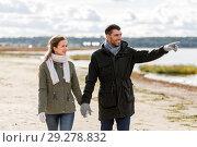 Купить «couple walking along autumn beach», фото № 29278832, снято 29 сентября 2018 г. (c) Syda Productions / Фотобанк Лори