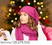 Купить «woman with shopping bags over christmas lights», фото № 29279532, снято 10 октября 2010 г. (c) Syda Productions / Фотобанк Лори