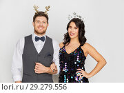 Купить «couple with christmas or new year party props», фото № 29279556, снято 15 декабря 2017 г. (c) Syda Productions / Фотобанк Лори