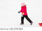 little girl with sleds on snow hill in winter. Стоковое фото, фотограф Syda Productions / Фотобанк Лори