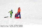 Купить «happy kids with sled having fun outdoors in winter», фото № 29279580, снято 10 февраля 2018 г. (c) Syda Productions / Фотобанк Лори