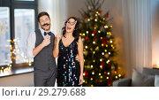Купить «happy couple with party props having fun», фото № 29279688, снято 15 декабря 2017 г. (c) Syda Productions / Фотобанк Лори