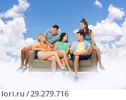 Купить «friends sitting on sofa over sky and clouds», фото № 29279716, снято 30 июня 2018 г. (c) Syda Productions / Фотобанк Лори