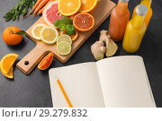 Купить «close up of fruits, juices and notebook on table», фото № 29279832, снято 4 апреля 2018 г. (c) Syda Productions / Фотобанк Лори