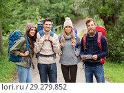 Купить «friends or travelers hiking with backpacks and map», фото № 29279852, снято 31 августа 2014 г. (c) Syda Productions / Фотобанк Лори