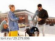 Купить «friends cooking meat on bbq at rooftop party», фото № 29279896, снято 2 сентября 2018 г. (c) Syda Productions / Фотобанк Лори