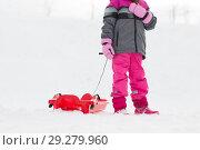 Купить «little girl with sled outdoors in winter», фото № 29279960, снято 10 февраля 2018 г. (c) Syda Productions / Фотобанк Лори