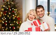 Купить «happy couple with christmas gifts at home», фото № 29280052, снято 7 октября 2012 г. (c) Syda Productions / Фотобанк Лори
