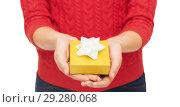 Купить «close up of woman in red sweater holding gift box», фото № 29280068, снято 10 сентября 2014 г. (c) Syda Productions / Фотобанк Лори