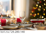 Купить «table setting for christmas dinner at home», фото № 29280140, снято 14 декабря 2017 г. (c) Syda Productions / Фотобанк Лори