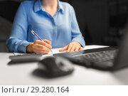 Купить «businesswoman with papers working at night office», фото № 29280164, снято 3 января 2018 г. (c) Syda Productions / Фотобанк Лори