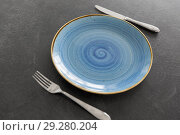 Купить «close up of plate, fork and knife on table», фото № 29280204, снято 4 апреля 2018 г. (c) Syda Productions / Фотобанк Лори