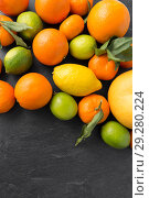 Купить «close up of citrus fruits on stone table», фото № 29280224, снято 4 апреля 2018 г. (c) Syda Productions / Фотобанк Лори