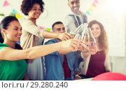 Купить «happy team with drinks celebrating at office party», фото № 29280240, снято 3 сентября 2017 г. (c) Syda Productions / Фотобанк Лори