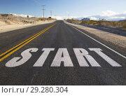 Купить «close up of word start on suburban asphalt road», фото № 29280304, снято 3 марта 2018 г. (c) Syda Productions / Фотобанк Лори
