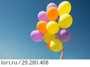 Купить «close up of colorful helium balloons in blue sky», фото № 29280408, снято 29 мая 2018 г. (c) Syda Productions / Фотобанк Лори