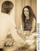 Купить «Young couple serving table at home», фото № 29289608, снято 12 ноября 2019 г. (c) Яков Филимонов / Фотобанк Лори