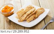 Купить «Chicken strips in sesame with sauce», фото № 29289952, снято 19 декабря 2018 г. (c) Яков Филимонов / Фотобанк Лори
