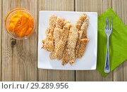 Купить «Fried chicken fingers from fillet in sesame served at plate on table», фото № 29289956, снято 23 мая 2019 г. (c) Яков Филимонов / Фотобанк Лори