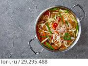 Купить «overhead view of duck noodle soup», фото № 29295488, снято 19 октября 2018 г. (c) Oksana Zh / Фотобанк Лори