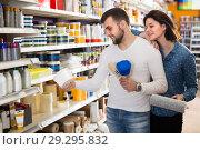 Купить «Man and woman are deciding on best paint», фото № 29295832, снято 9 марта 2017 г. (c) Яков Филимонов / Фотобанк Лори
