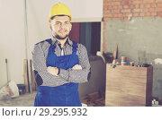 Купить «Portrait of workman which is doing repair», фото № 29295932, снято 3 июня 2017 г. (c) Яков Филимонов / Фотобанк Лори