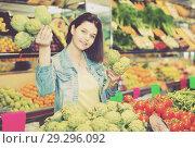 Купить «Woman choosing fruit», фото № 29296092, снято 18 марта 2017 г. (c) Яков Филимонов / Фотобанк Лори
