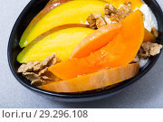 Tasty pumpkin and mango served with whipped cream and oat-flakes at plate. Стоковое фото, фотограф Яков Филимонов / Фотобанк Лори