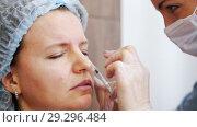 Купить «Woman in a cosmetology clinic. Specialist sticks in a needle in clients under eye», видеоролик № 29296484, снято 16 июля 2019 г. (c) Константин Шишкин / Фотобанк Лори