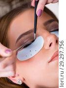 Купить «Young woman getting eyelash extension», фото № 29297756, снято 29 января 2018 г. (c) Elnur / Фотобанк Лори