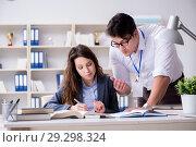 Купить «Teacher explaining to student at lecture», фото № 29298324, снято 11 марта 2017 г. (c) Elnur / Фотобанк Лори
