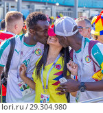 Купить «Russia, Samara, June 2018: A cheerful football fan from Senegal kisses a fan from Colombia.», фото № 29304980, снято 28 июня 2018 г. (c) Акиньшин Владимир / Фотобанк Лори