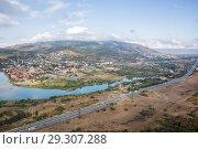 Купить «Top view of Georgian Military Road, Aragvi River and town of Mtskheta», фото № 29307288, снято 23 сентября 2018 г. (c) Юлия Бабкина / Фотобанк Лори